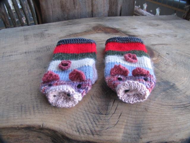 a pair of piggy mittens