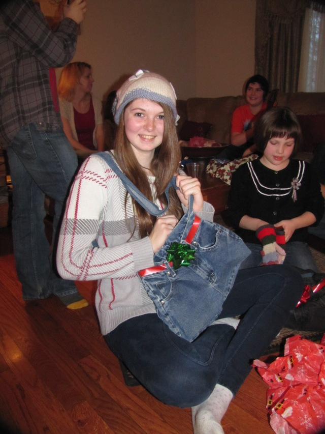 Kaitlyn wearing her Fish Hat with her wrapping jean bag