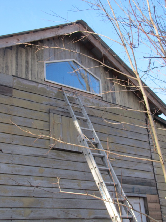 back of barn with siding around window