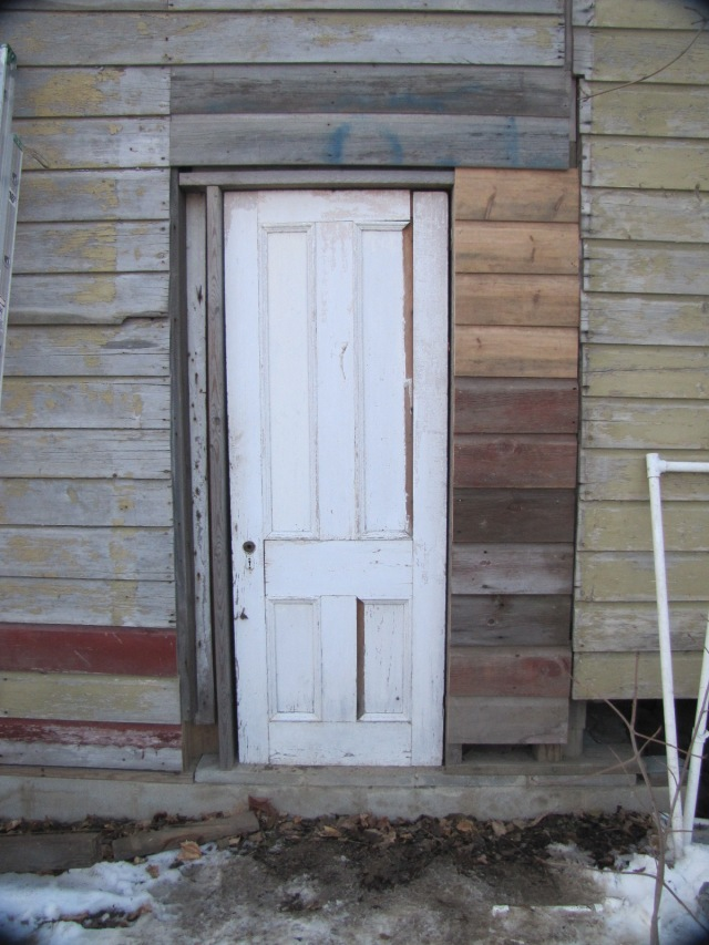 The door with most of the siding up
