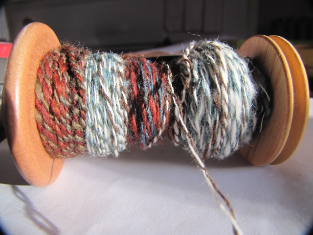 close up of emptied bobbins plied