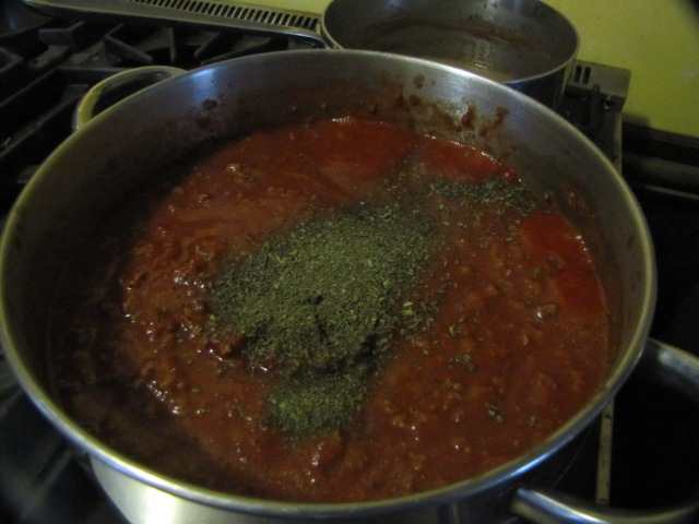 meat sauce with herbs on top