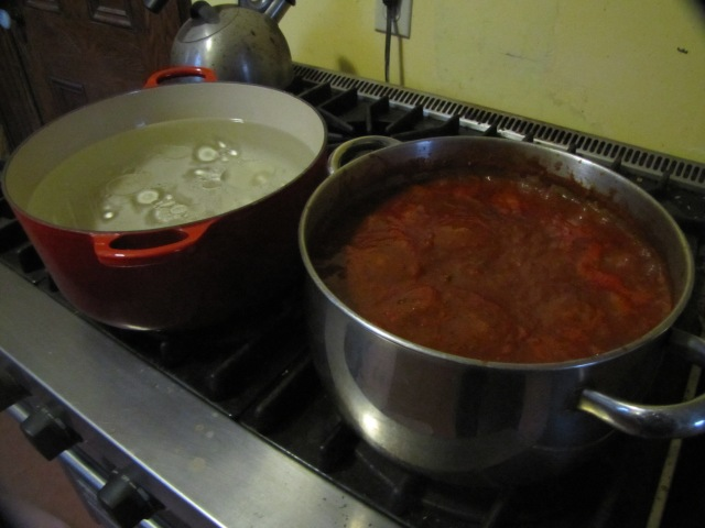water and sauce on stove
