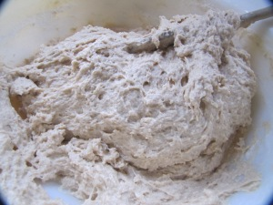 mixing in the flour into the bread dough