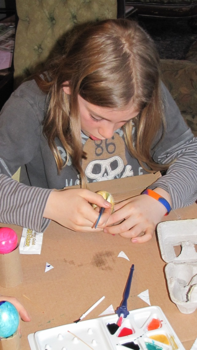 Jesse painting eggs
