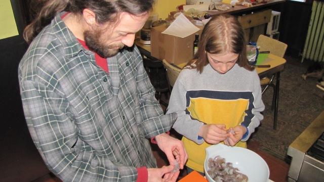 Chip and Jesse peeling shrimp