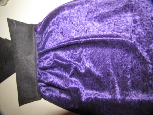 collar sewn onto outside of cape